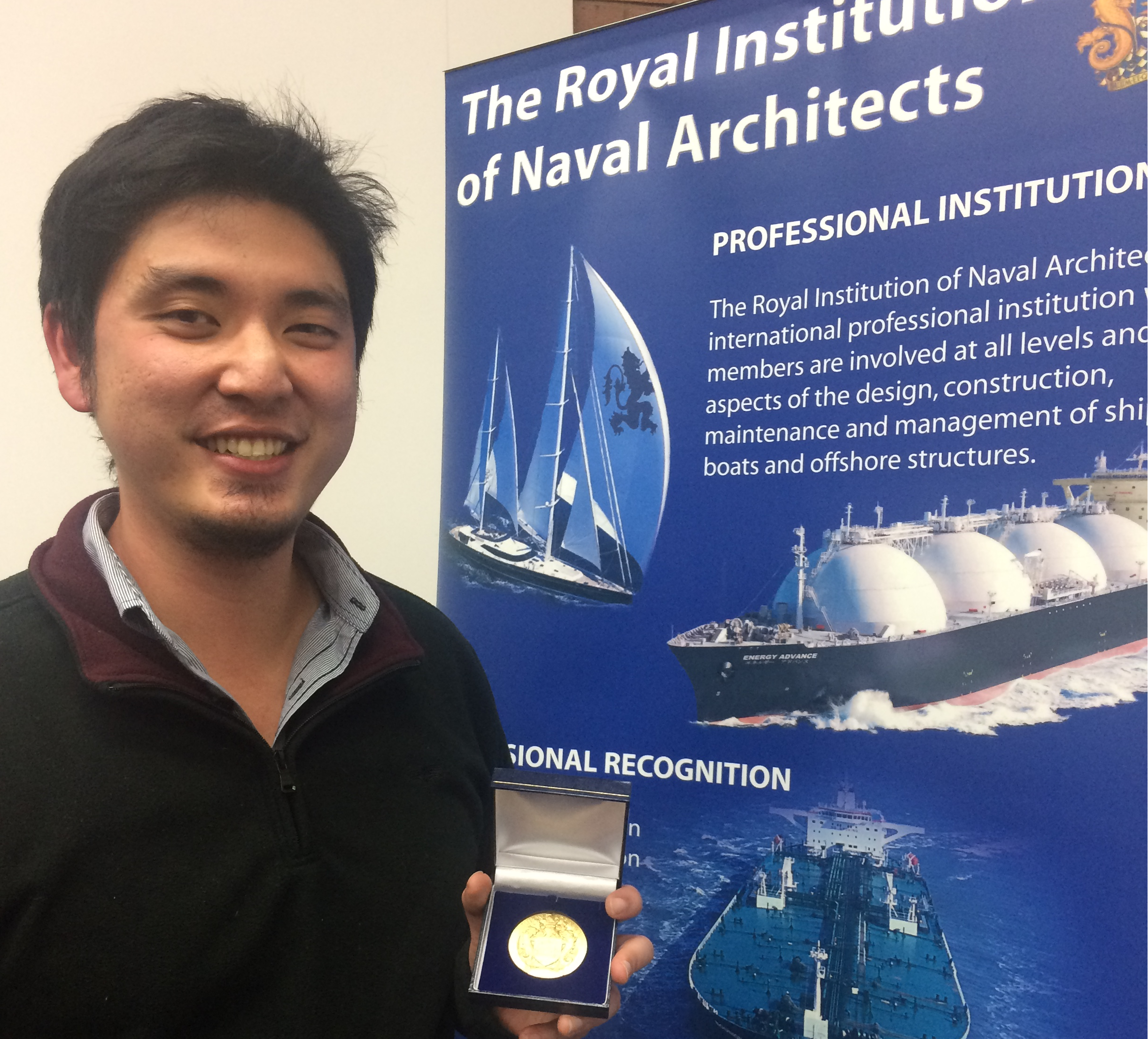Dr Zhi Leong with his RINA medal